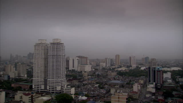Fog covers the Manila skyline. Available in HD.