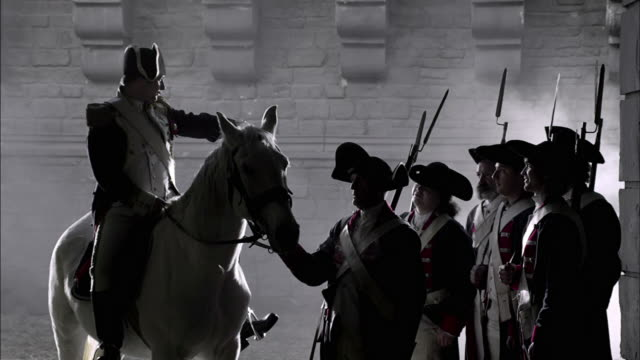fog drifts around a military leader on horseback and soldiers in french revolution uniforms. - french revolution stock videos & royalty-free footage