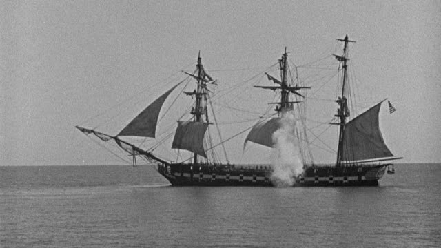 """fog drifts around the sails of the sailing ship """"pilgrim""""; a galleon fires its cannons. - artillery stock videos & royalty-free footage"""