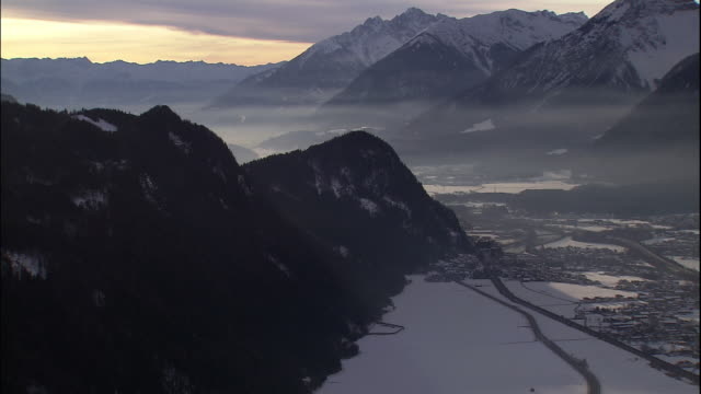 fog drifts over a mountain valley in winter. - tyrol state austria stock videos and b-roll footage