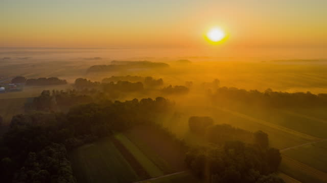 h/l fog floating over cultivated fields - twilight stock videos & royalty-free footage