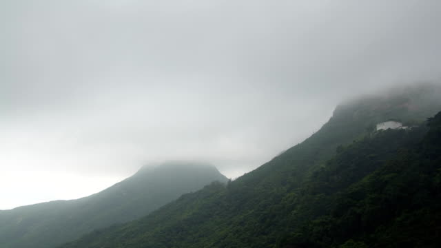 fog flowing over mountains time lapse - hong kong island stock videos & royalty-free footage