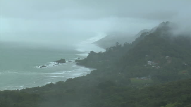HA WS Fog hovering above coast along Playa Dominical / Dominical, Puntarenas Province, Costa Rica
