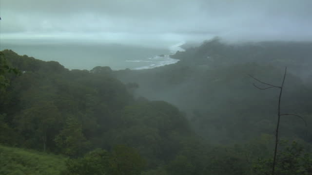 HA WS Fog hovering above mountain peak with view of coast along Playa Dominical / Dominical, Puntarenas Province, Costa Rica