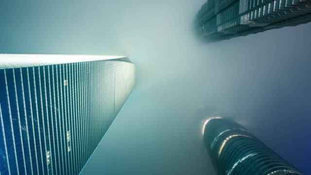 fog in shanghai at night - 真下からの眺め点の映像素材/bロール