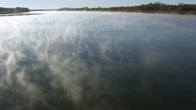 WS TU AERIAL POV Fog moving over Missouri River / North Dakota, United States