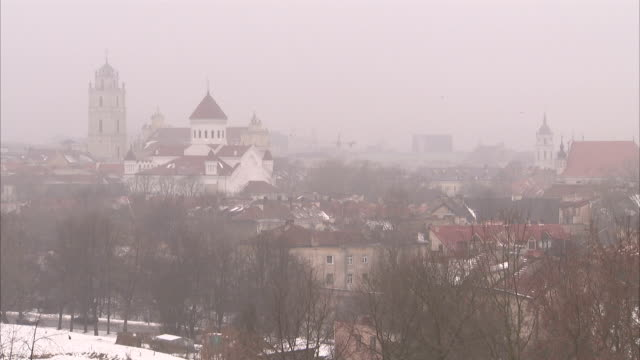 Fog obscures downtown Siauliai on a winter day. Available in HD.