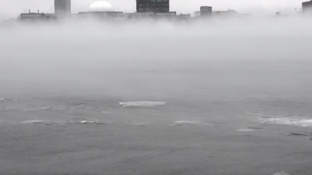 Fog over and icy Delaware River between Camden NJ and Philadelphia PA on January 12 2018 as warmer temperatures and heavy rainfall follow a period of...