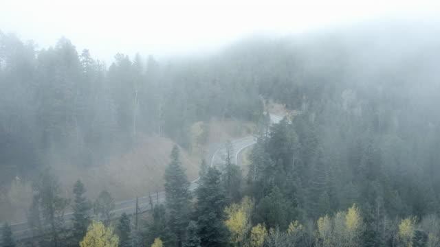 Fog over mountain road, Santa Fe, New Mexico, United States