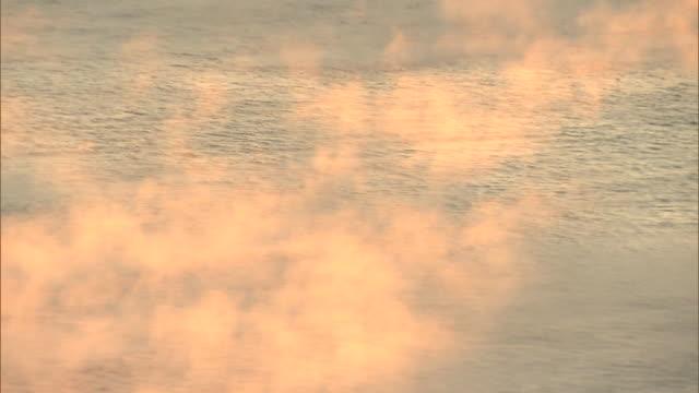 fog rising over the inland sea (setonaikai) - light natural phenomenon stock videos & royalty-free footage