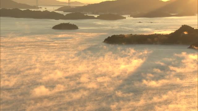 fog rising over the inland sea (setonaikai) - nishiseto expressway stock videos & royalty-free footage
