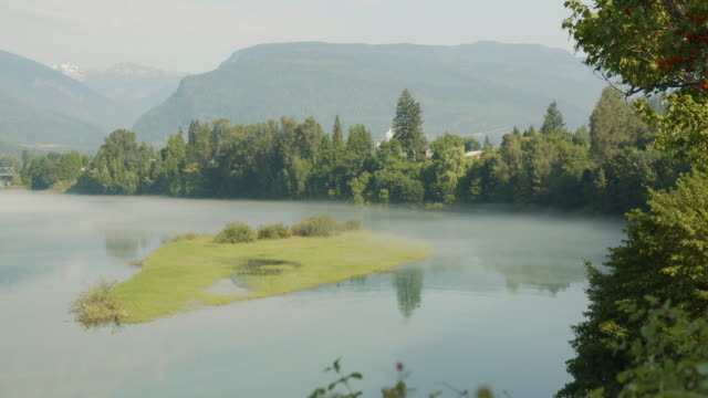fog rolling along water in the morning in revelstoke, vii-ii - polarizer stock videos & royalty-free footage