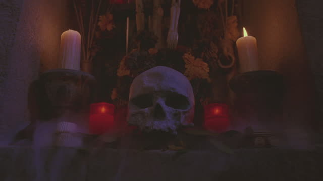 fog rolls off a altar lit with candles. - shrine stock videos and b-roll footage