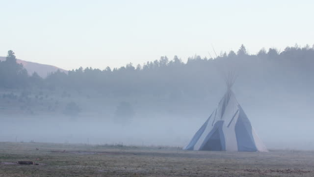 fog rolls over teepee on apache reservation, wide shot - reservation stock videos & royalty-free footage