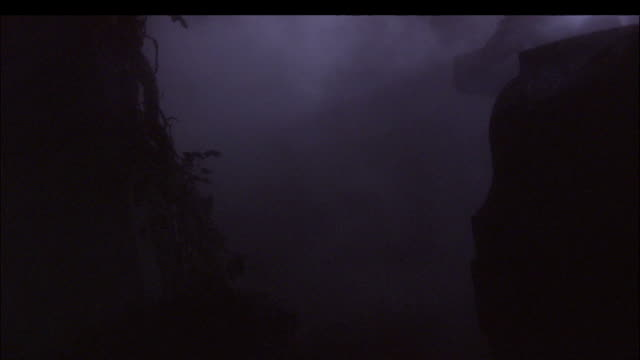 fog rolls through a cemetery. - transilvania video stock e b–roll