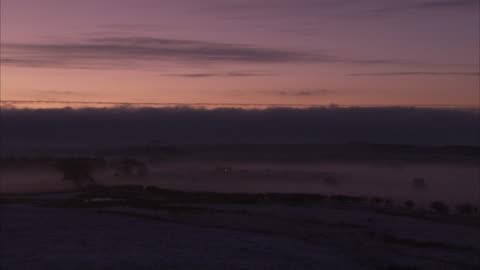 a fog settles over a northumberland valley. available in hd. - northumberland bildbanksvideor och videomaterial från bakom kulisserna