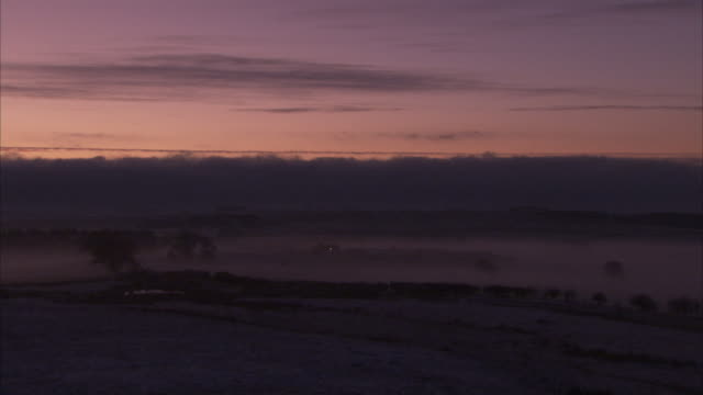 a fog settles over a northumberland valley. available in hd. - northumberland stock videos & royalty-free footage