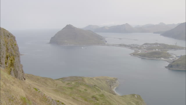 fog settles over dutch harbor in alaska. - aleutian islands stock videos and b-roll footage