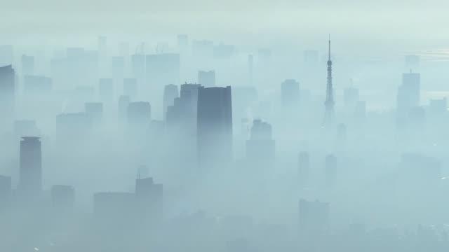 aerial, fog shrouded tokyo skyline, japan - 通信点の映像素材/bロール