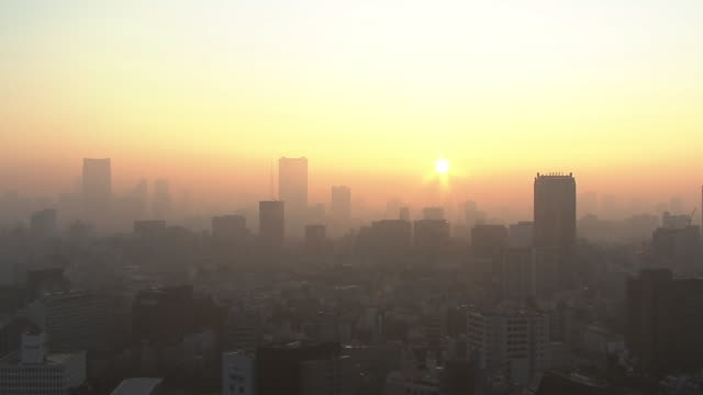 fog shrouded tokyo skyline shot from nhk, shibuya, japan - fog stock videos & royalty-free footage