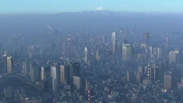 AERIAL, Fog Shrouded Tokyo Skyline With Mt. Fuji, Japan