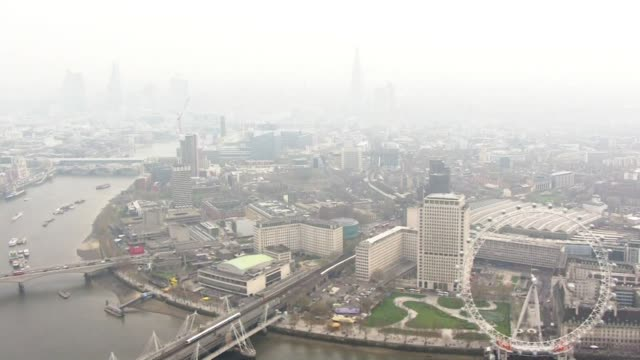 fog, smog and air pollution over city of london - smog stock videos & royalty-free footage
