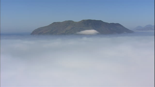 Fog surrounds Italy's Isola di Vulcano.