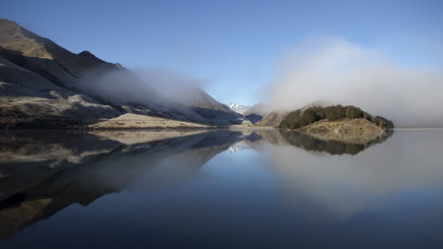 ws t/l fog undulating above and reflecting in moke lake / queenstown, new zealand  - queenstown stock videos & royalty-free footage