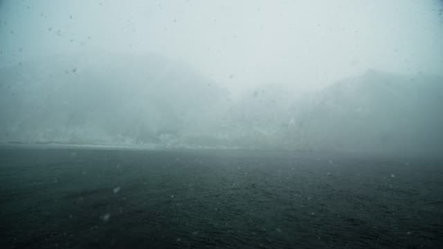 foggy and snowy hoddevik, norway - west direction stock videos & royalty-free footage