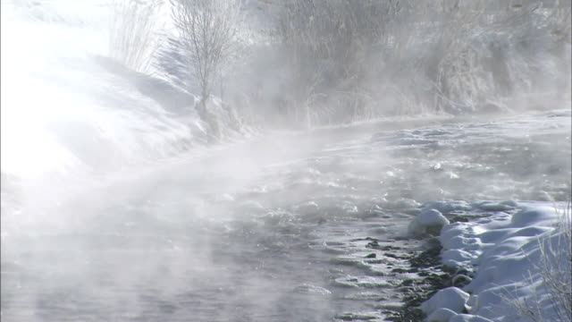 foggy biei river in the morning. - biei town stock videos & royalty-free footage