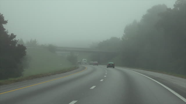 Foggy day driving on curved highway