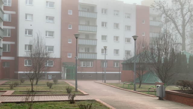 Foggy day in residential area in European city
