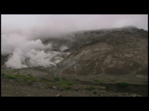 ws  pan foggy gasses escaping from ground at mount usu  hokkaido  japan - fuggire video stock e b–roll