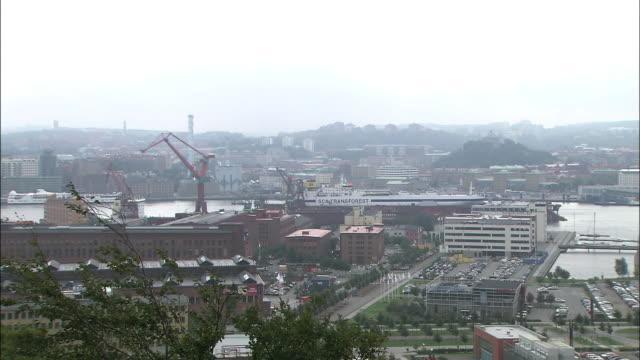 A foggy haze hangs over parking lots in an industrial area in Gothenburg, Sweden.