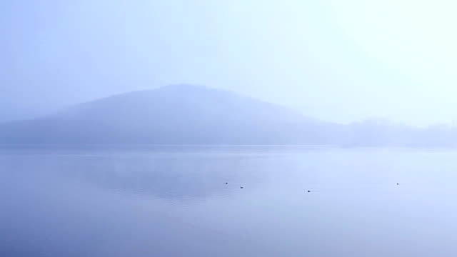 Foggy Island and lake in Reflection in the morning