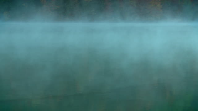 foggy lake weissensee - carinthia (gailtal alps) - carinthia stock videos & royalty-free footage