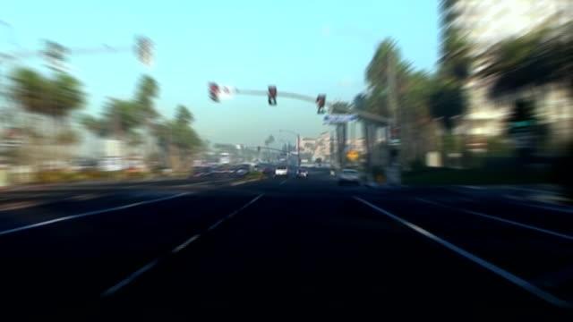 foggy morning drive in huntington beach, california - huntington beach california stock videos and b-roll footage