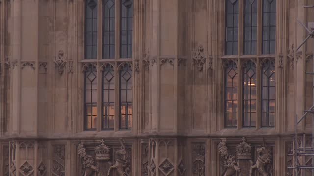 foggy parliament gvs; england: london: westminster: ext various of the houses of parliament seen through light mist and river thames in f/g gv... - clock tower stock videos & royalty-free footage