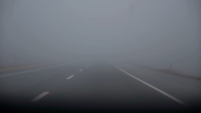 foggy road - road marking stock videos & royalty-free footage