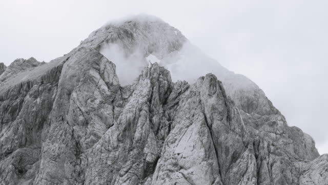 aerial foggy rugged mountain top - slovenia stock videos & royalty-free footage