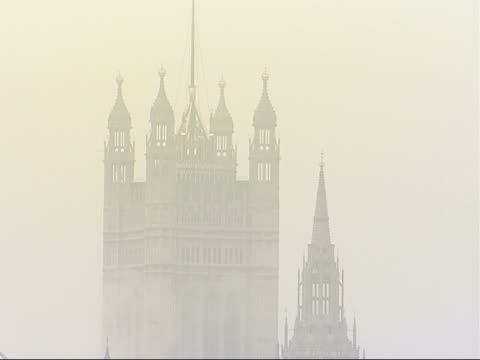 london westminster general views of houses of parliament and westminster abbey views in fog across the river thames from the south bank with charing... - charing cross stock videos and b-roll footage