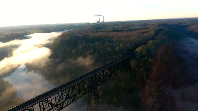 foggy sunrise over bridge - railway bridge stock videos & royalty-free footage