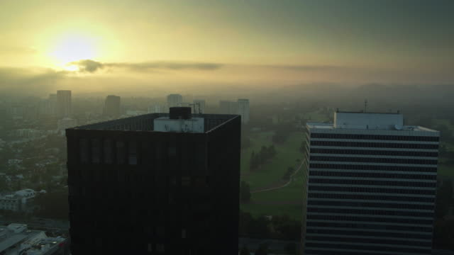 foggy sunset in century city, los angeles - drone shot - century city stock videos & royalty-free footage