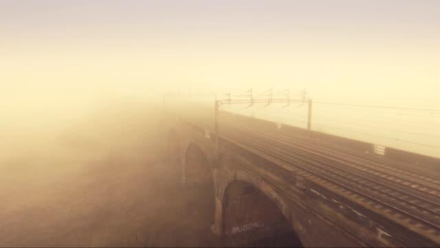 foggy viaduct - railway track stock videos & royalty-free footage