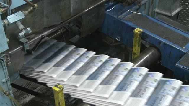 cu folded newspapers on printer's conveyor belt, san francisco, california, usa / audio - folded paper stock videos and b-roll footage