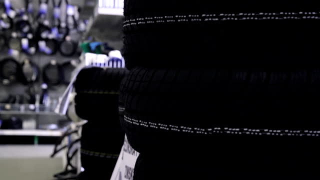 folded tyres in the store - tyre stock videos & royalty-free footage