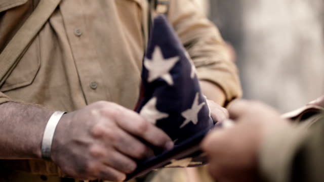 folding american flag - marines stock videos & royalty-free footage