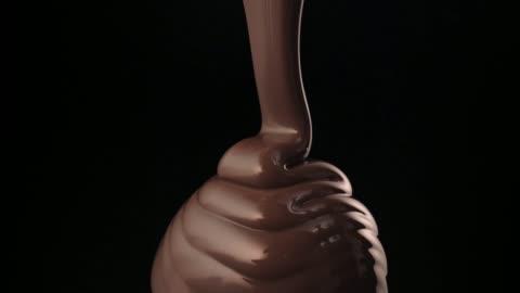folding chocolate flow - chocolate stock videos & royalty-free footage