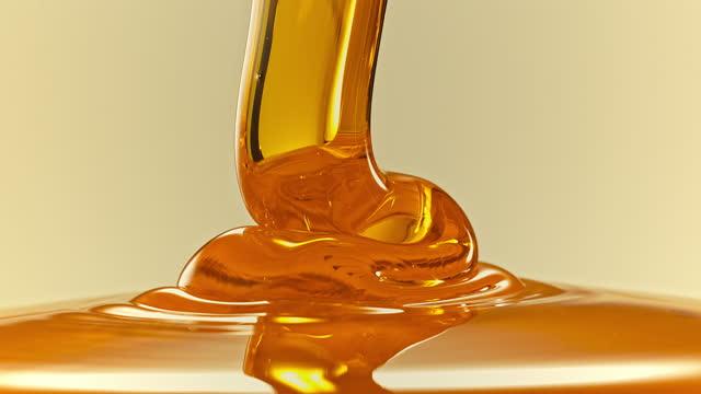 folding honey flow - flowing stock videos & royalty-free footage