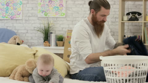 folding laundry - washing stock videos & royalty-free footage